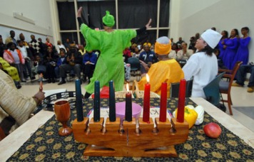 McCrorey YMCA dancers and drummers warm up the crowd with lively rhythms and traditional colorful costumes at the beginning of the Kwanzaa celebration Wednesday evening at Freedom Regional Library on Alleghany St. DIEDRA LAIRD - dlaird@charlotteobserver.com